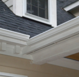 the-bright-white-seamless-aluminum-gutters-installed-by-nc-gutter-guys-inc-now-protect-this-home-from-the-serious-erosion-that-had-occurred-around-its-foundation-threatening-the-home-owner-with-